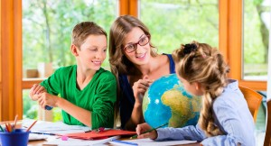45394031 - homeschooling mother teaching kids private lessons in geography